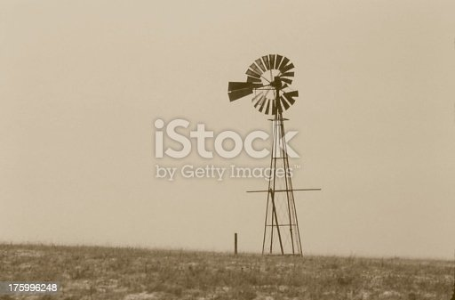 Old photo of an abandoned windmill.