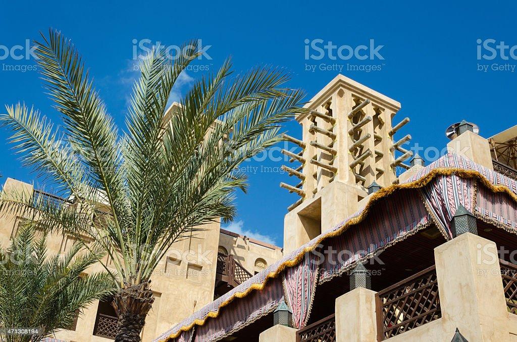 Old wind tower and palm trees, Bastakiya, Dubai, UAE. stock photo