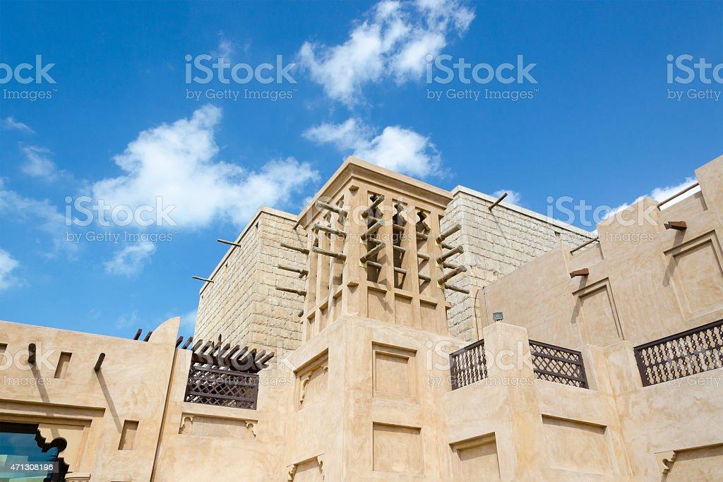 Old wind tower, Arabian architecture, Bastakiya, Dubai, UAE. stock photo