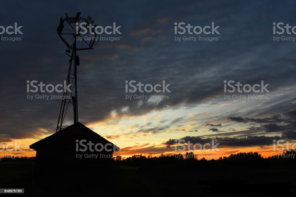 Old Wind Turbine Silhouette stock photo