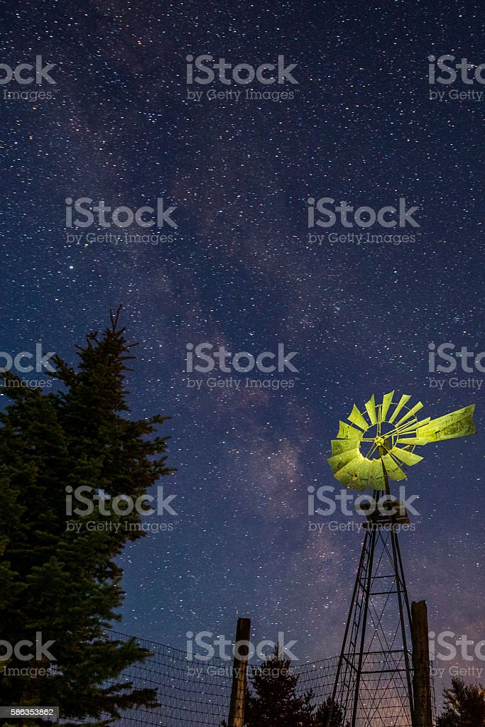 Old Windmill beneath the Milky Way stock photo
