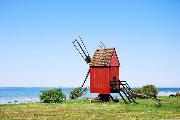 Old windmill by the coast stock photo