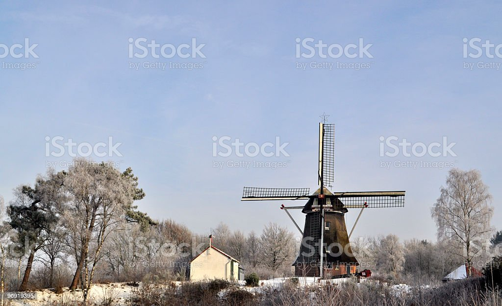 Old windmill in the snow royalty-free stock photo