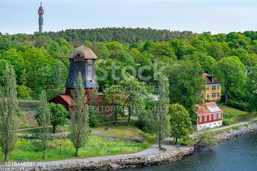 istock Old windmill on Djurgarden island, Stockholm, Sweden 1216446351