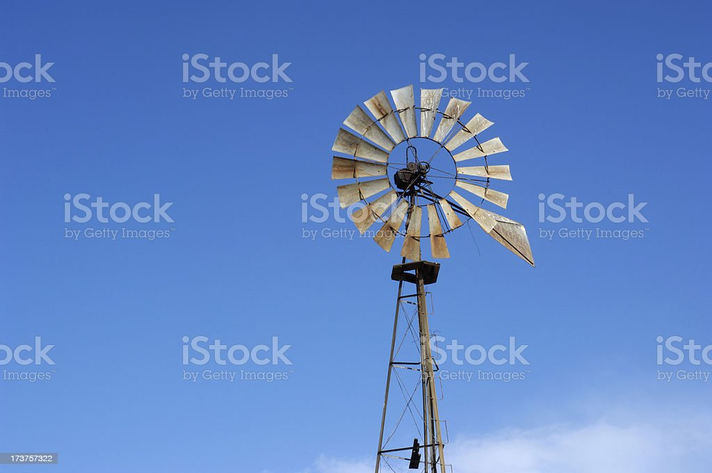 Old Windmill with Cloudy Sky in Background royalty-free stock photo