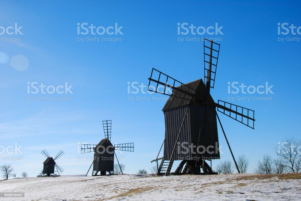 Old windmills in a row stock photo
