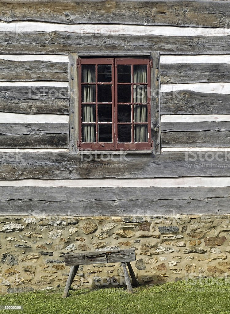 old window and a wooden bench royalty-free stock photo