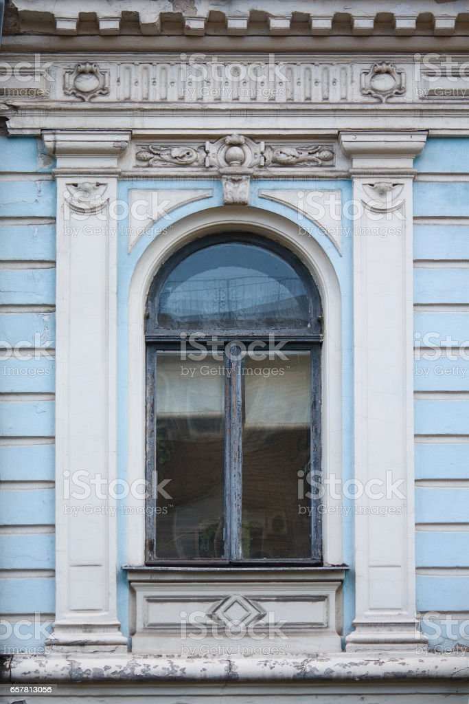 Old window in a classic style. Architecture stock photo