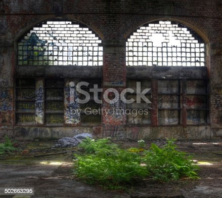 istock Old window in a deserted hall 502663295