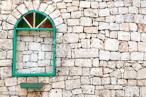 Old green window, dirty and rustic stone background