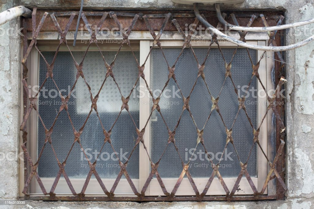 Old Window With A Rusty Iron Window Frames Stock Photo Download