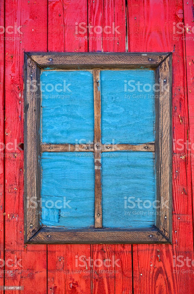 old  window with blue frame on red wooden wall stock photo