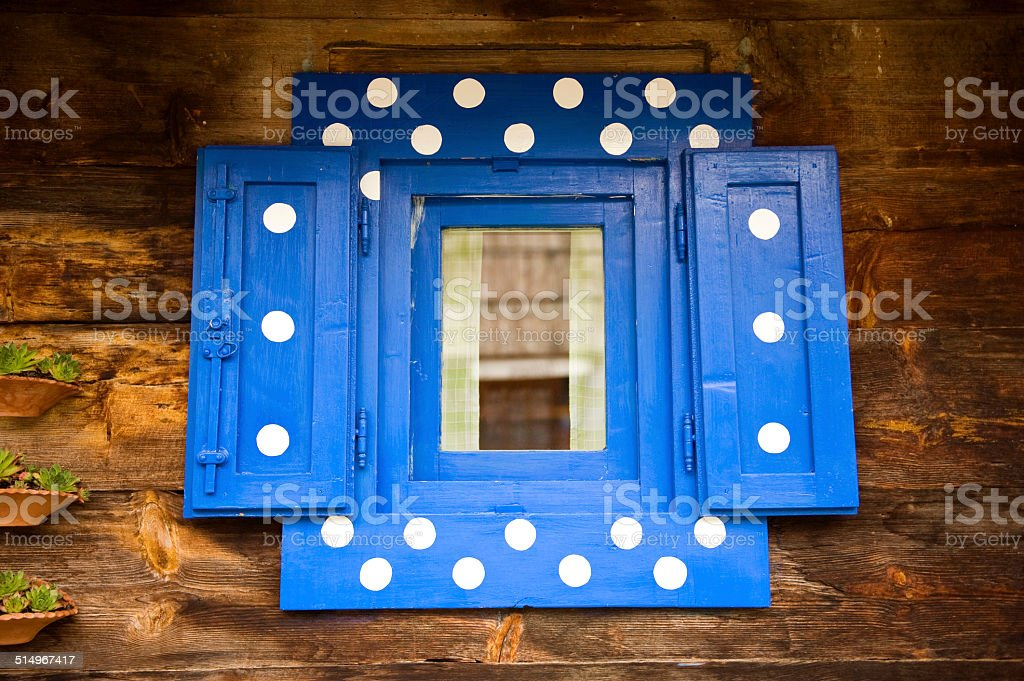 old window with blue frame stock photo