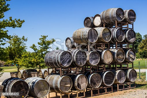Old Wooden Wine Barrels Stacked In Display At Winery