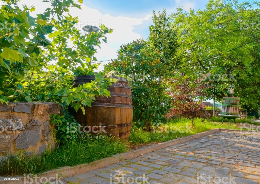 Old wine press and rustic wine barrel. Wine background in Europe. Czech Republic, South Moravia royalty-free stock photo