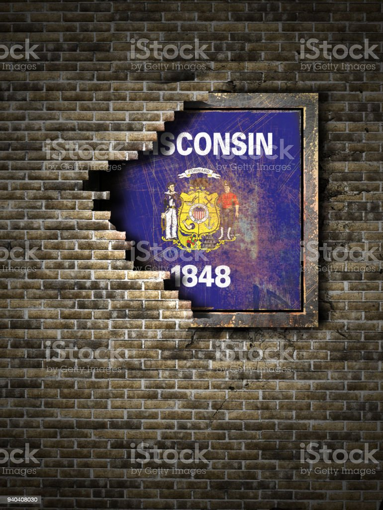 Old Wisconsin flag in brick wall stock photo