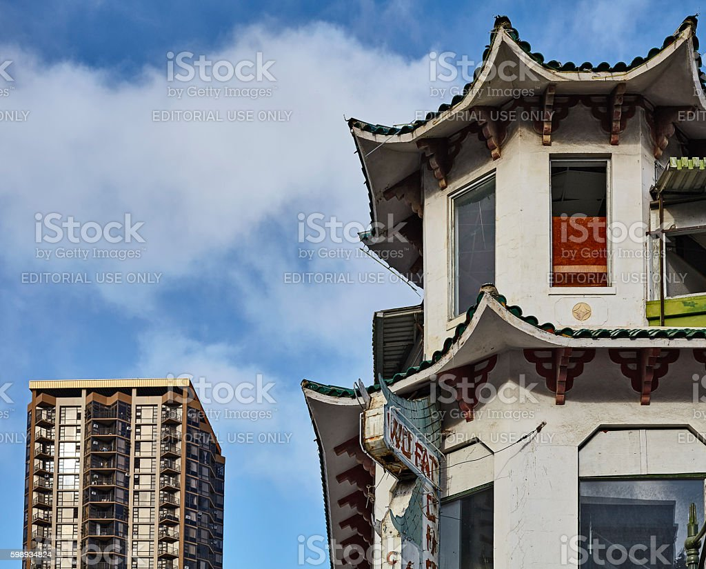 Old Wo Fat Chinese Restaurant and modern building downtown Honol stock photo