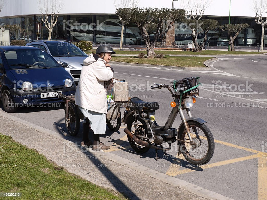 old woman and her handmade motorbike royalty-free stock photo