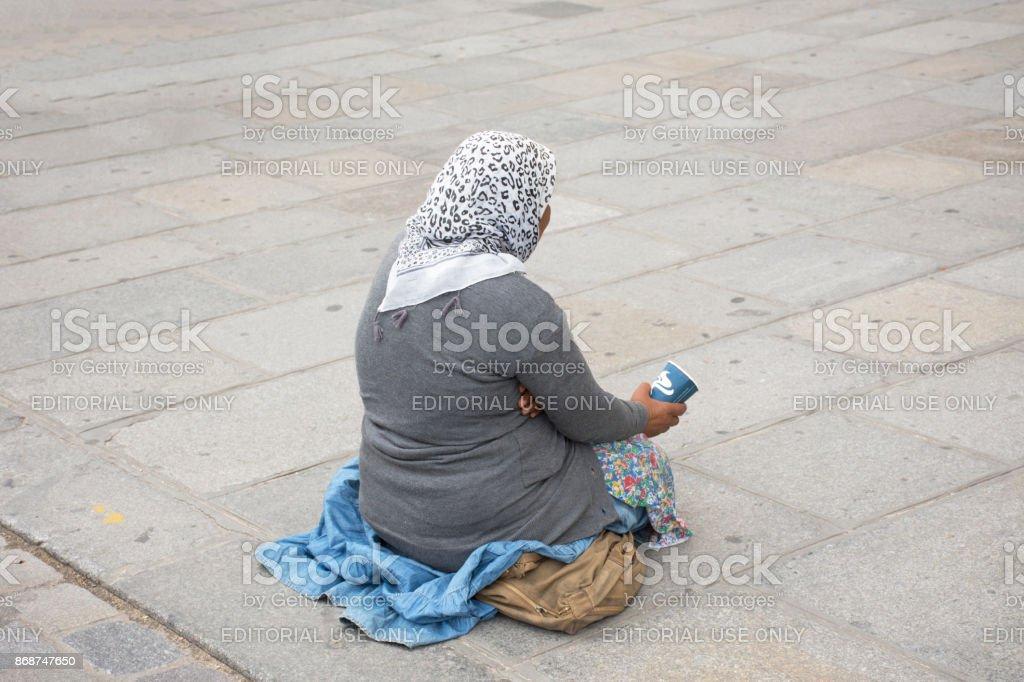 Old woman beggar sitting begging money stock photo