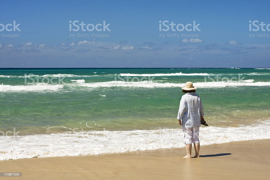 Old woman by the sea stock photo