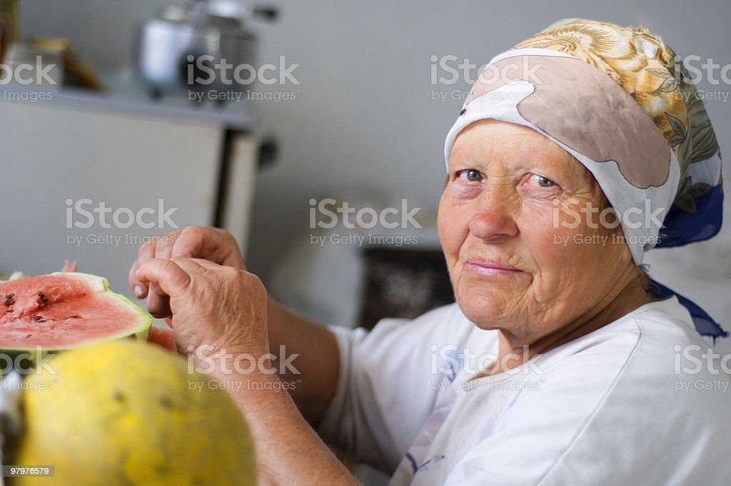 old woman eating a watermelon royalty-free stock photo