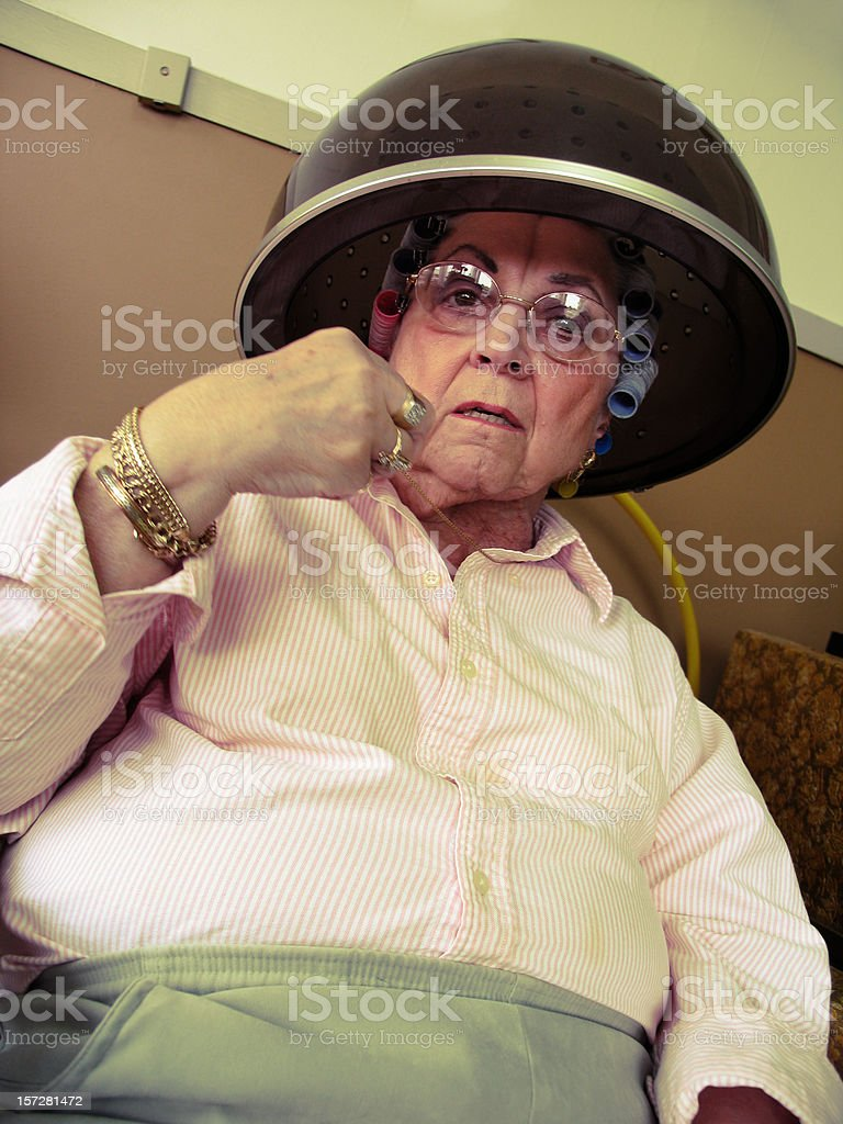 Old Woman Getting her Hair Dried royalty-free stock photo