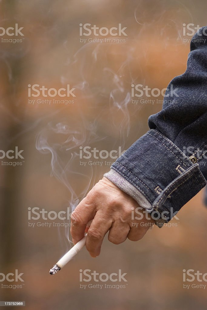 Old woman hand with cigarette royalty-free stock photo