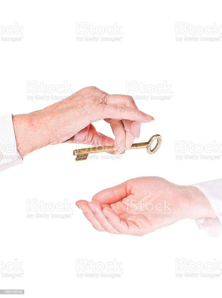 Old Woman Handing Keys royalty-free stock photo