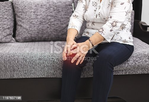 1133511905istockphoto Old woman have knee pain. Senior woman with knee injury has pain 1197837198