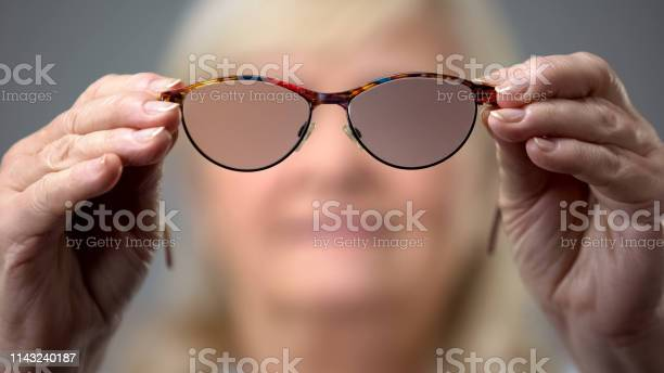 Old woman holding trendy glasses concept of vision problems blurred picture id1143240187?b=1&k=6&m=1143240187&s=612x612&h=lvuvvtphqyqx5ddj2d6ebospu0dnsch9c 6pbhvpaew=