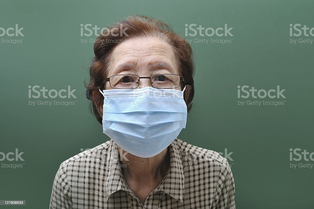 old woman in mask royalty-free stock photo
