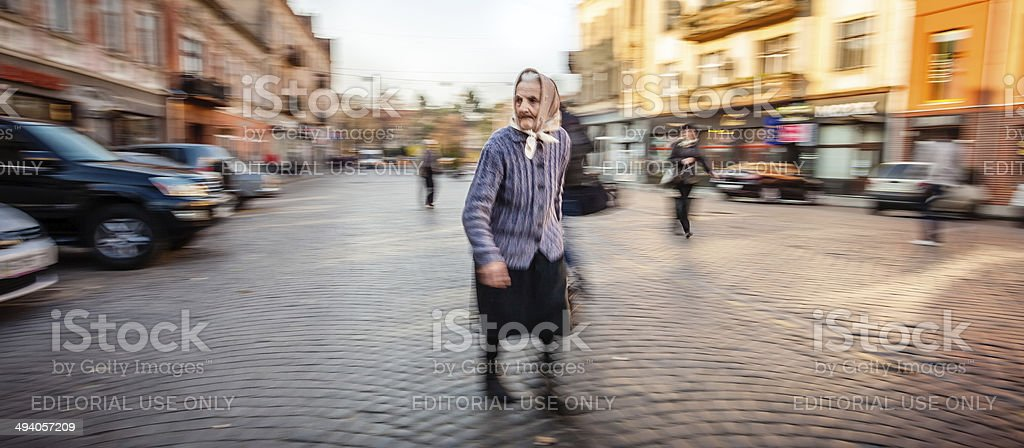Old woman in the early morning city royalty-free stock photo