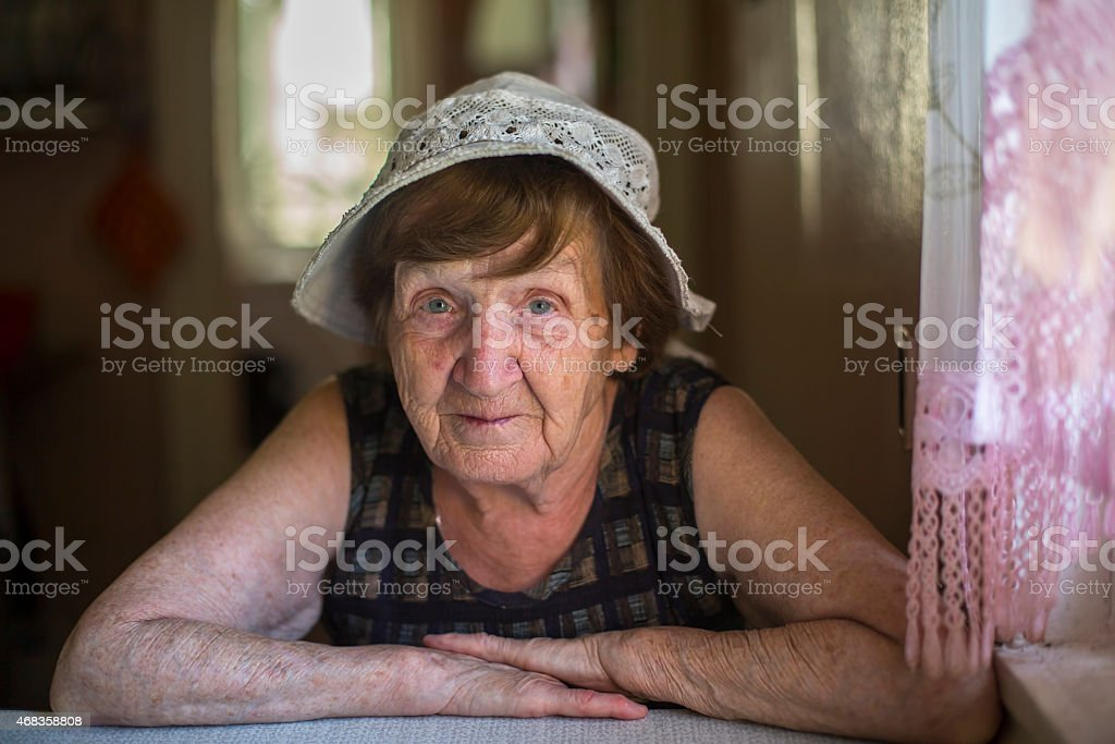Old woman in the kitchen of his farmhouse. royalty-free stock photo