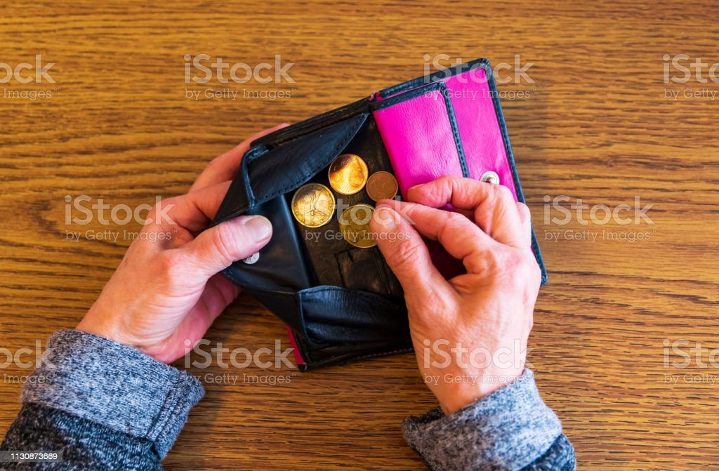A Old woman is broke. No more money in your wallet