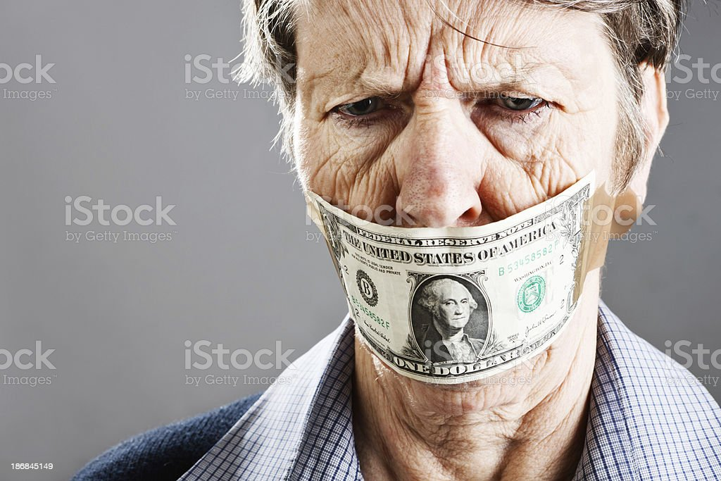 Old woman is irritated and confused by dollar bill gag stock photo