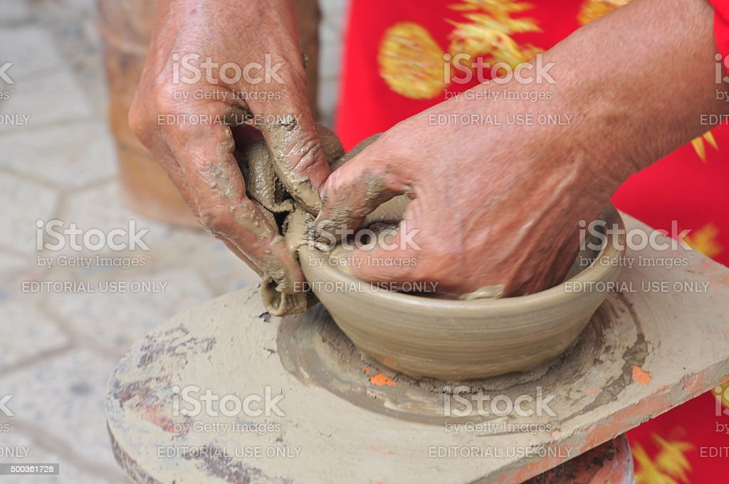 Old Woman Is Performing The Ceramic Molding Techniques Stock