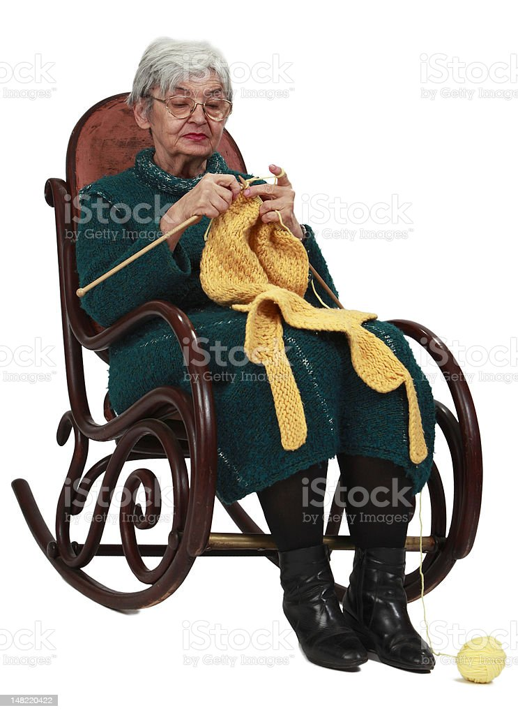 Old woman knitting stock photo