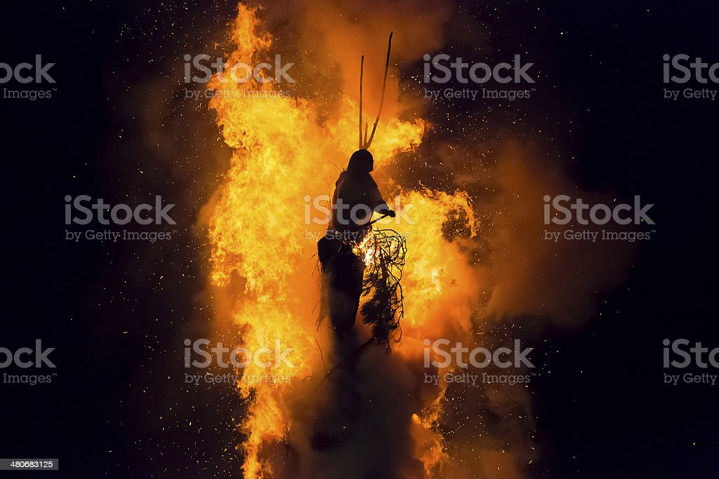 Old woman on bonfire stock photo