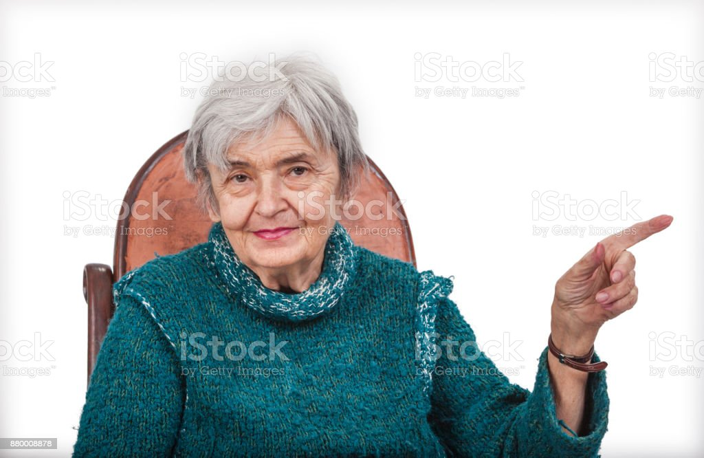 Old Woman Pointing Her Left Finger at Something stock photo