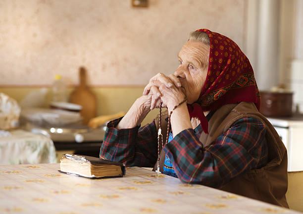 Old Woman Praying Stock Photo Istock