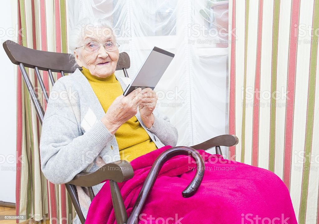 Old woman reading book stock photo