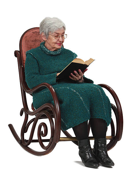 Old woman reading stock photo