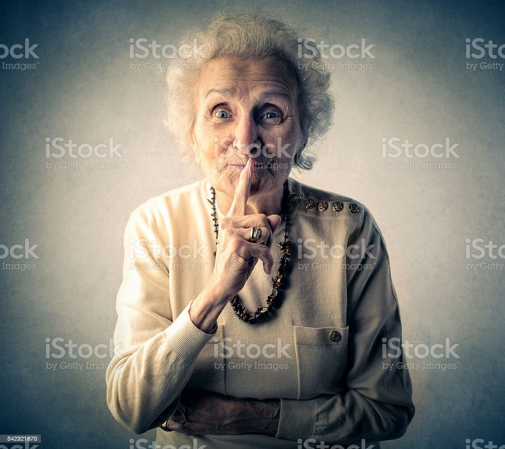 Old woman saying be quiet stock photo