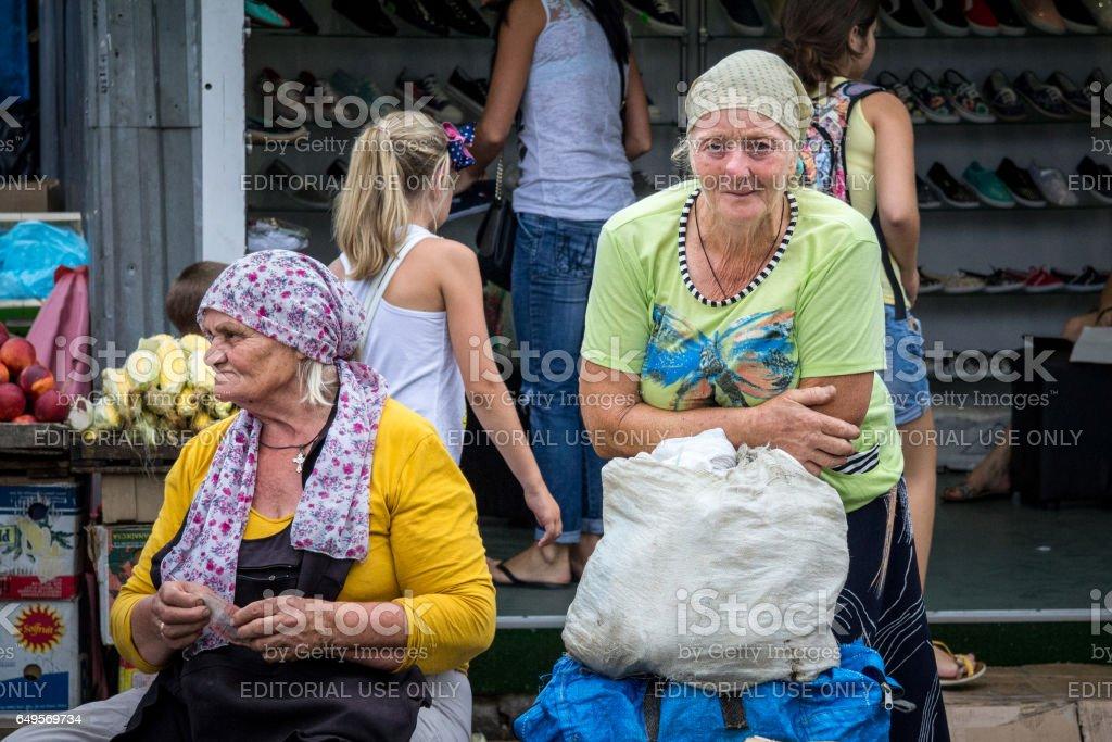 Odessa, Ukraine - August  13, 2015: Old woman selling vegetables on Privoz market, the main market of Odessa, Ukraine stock photo