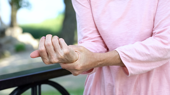 istock Old woman stretching numb arm, weakness of muscles in senior age, arthritis 1127406986