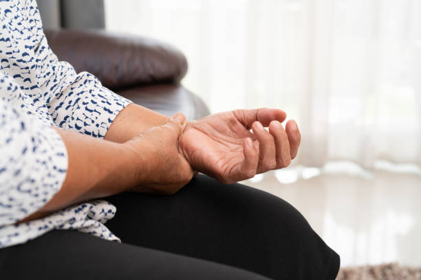 old woman suffering from wrist hand pain, health problem concept - human finger stock pictures, royalty-free photos & images