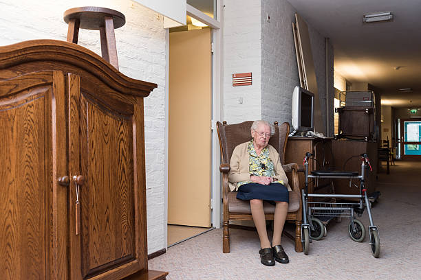 old woman suffers move into retirement home stock photo
