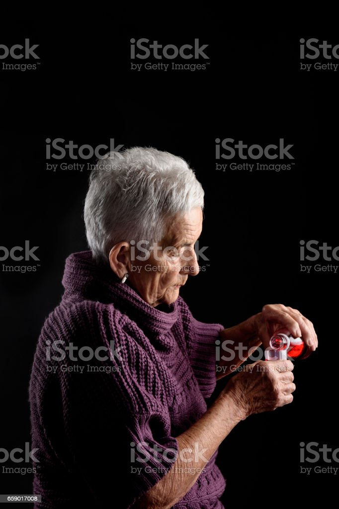 Old woman taking syrup royalty-free stock photo