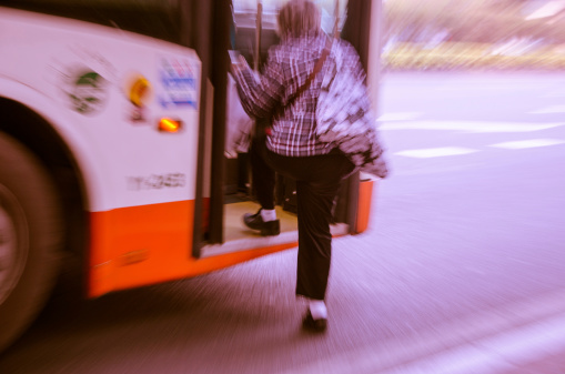 Old woman to ride the bus