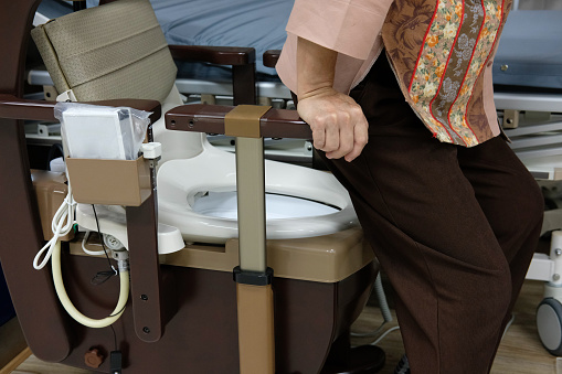 Old Woman Use Portable Mobile Plastic Toilet Near Patient ...